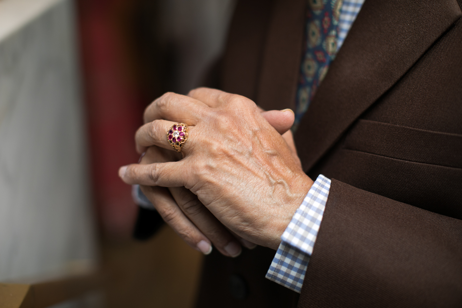 Close up of hands clasped.