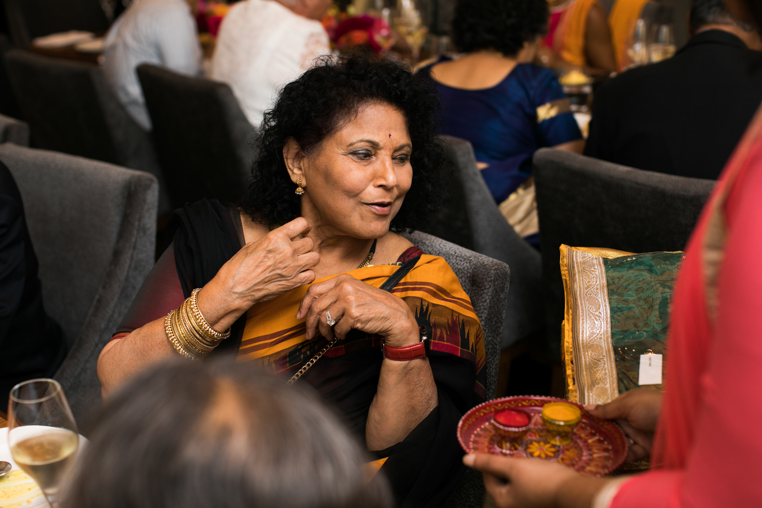 Offering Turmeric and Vermillion powders to ladies at a wedding reception.