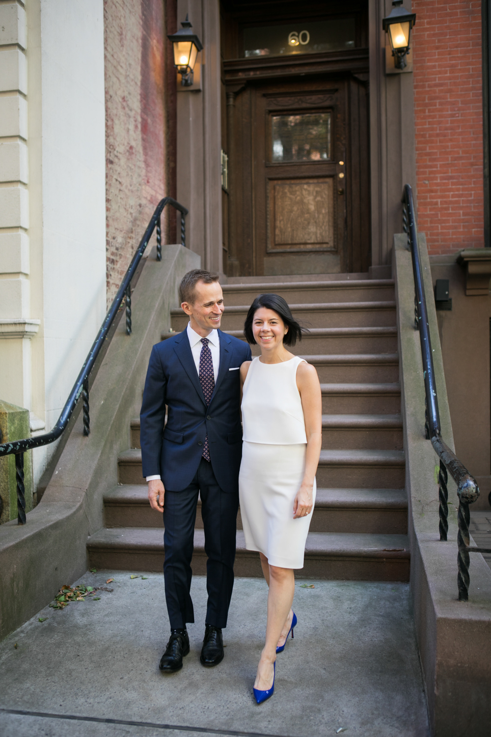 Bride and groom posing outside of a New York City stoop.