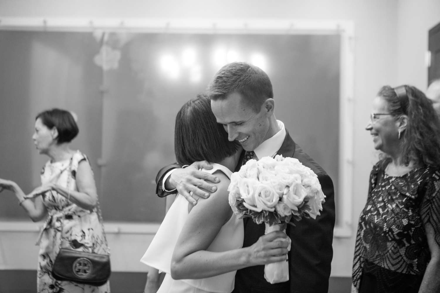 Couple embrace at their City Hall wedding in New York City.