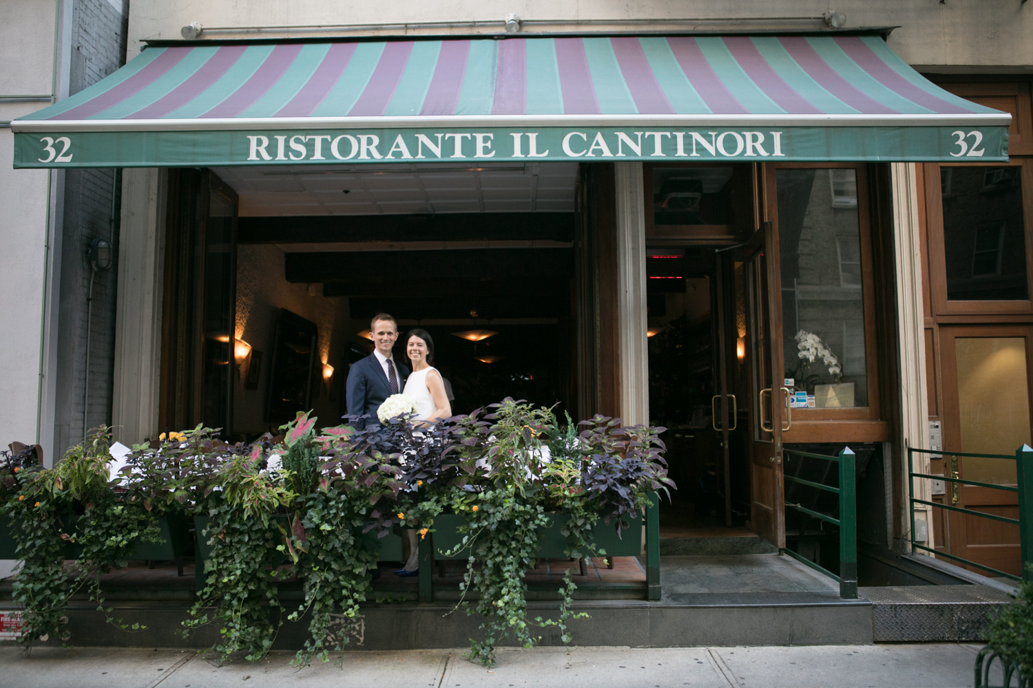 Portrait of newlyweds in front of Ristorante il Cantinori in Manhattan.