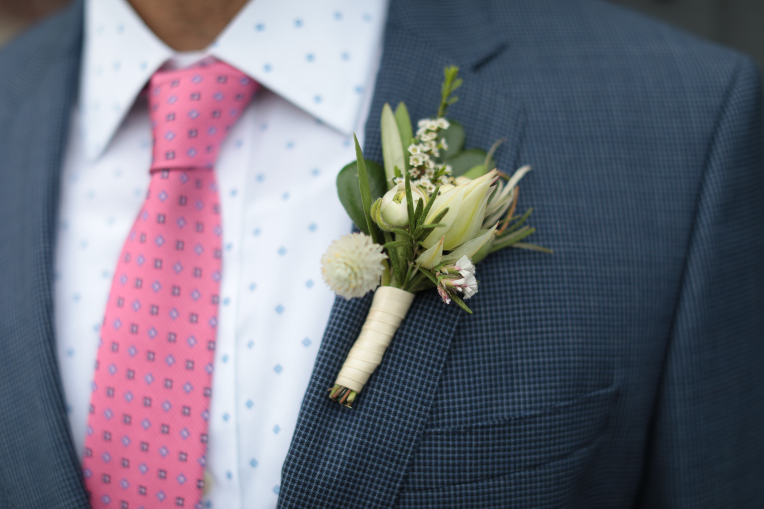 Close up portrait of the groom's boutinere.