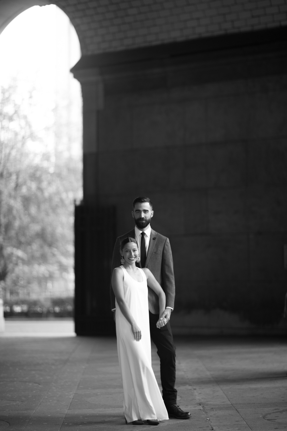 Black and white portrait of a bride and groom on their wedding day.
