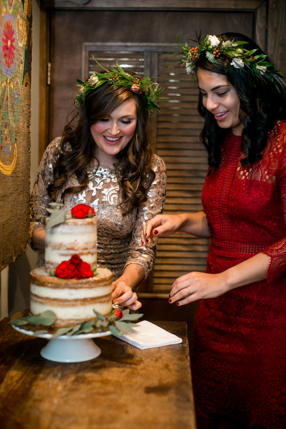 Brides cutting their Lucky Bird Bakery cake.
