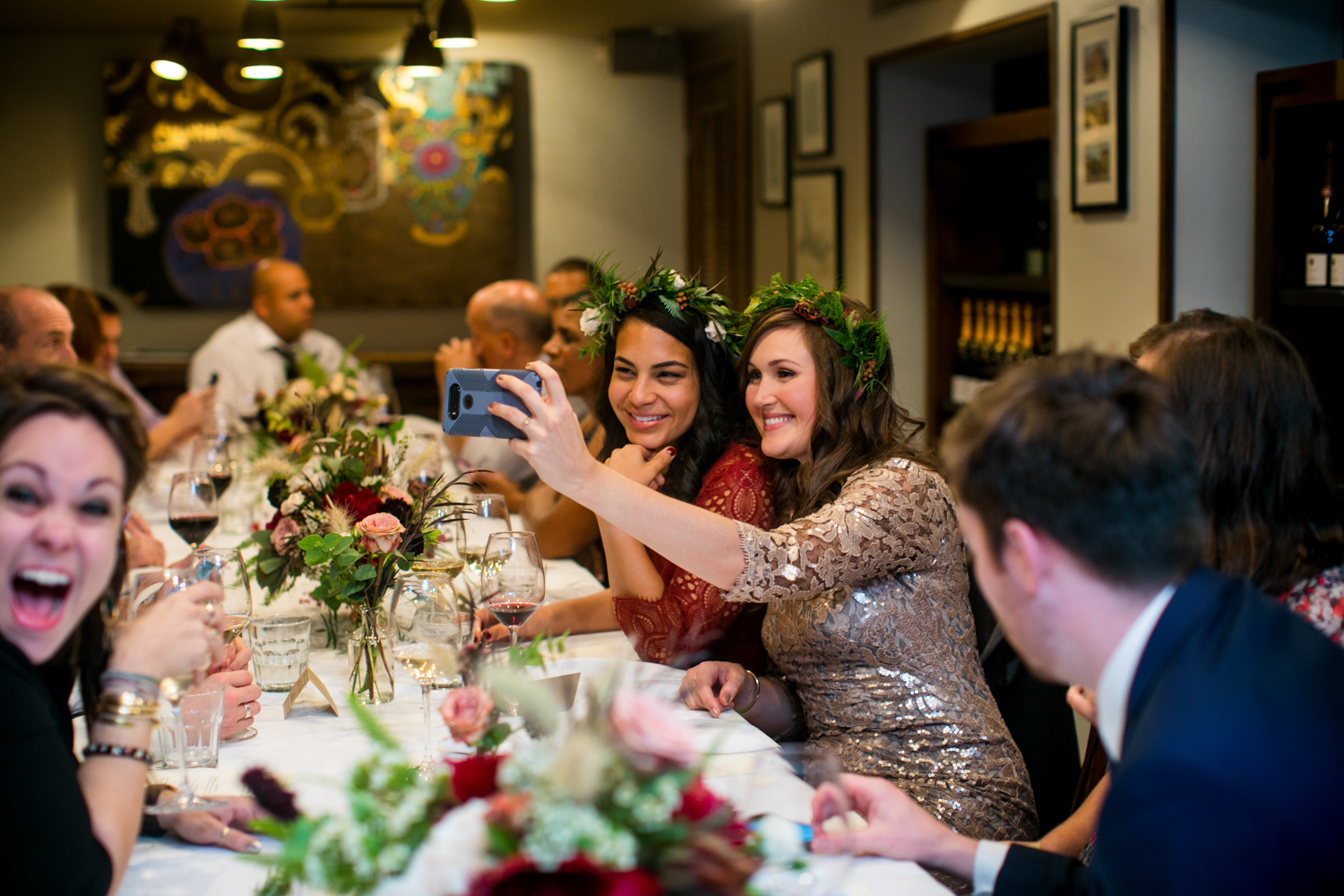 Brides take a selfie at their lunch wedding reception at Maialino in New York City.