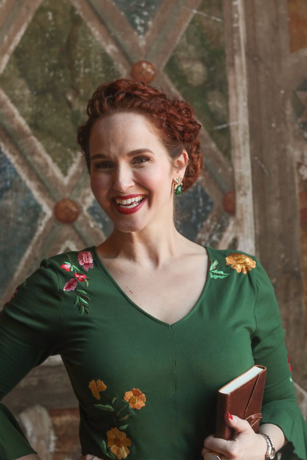 Portrait of the officiant in a green dress.