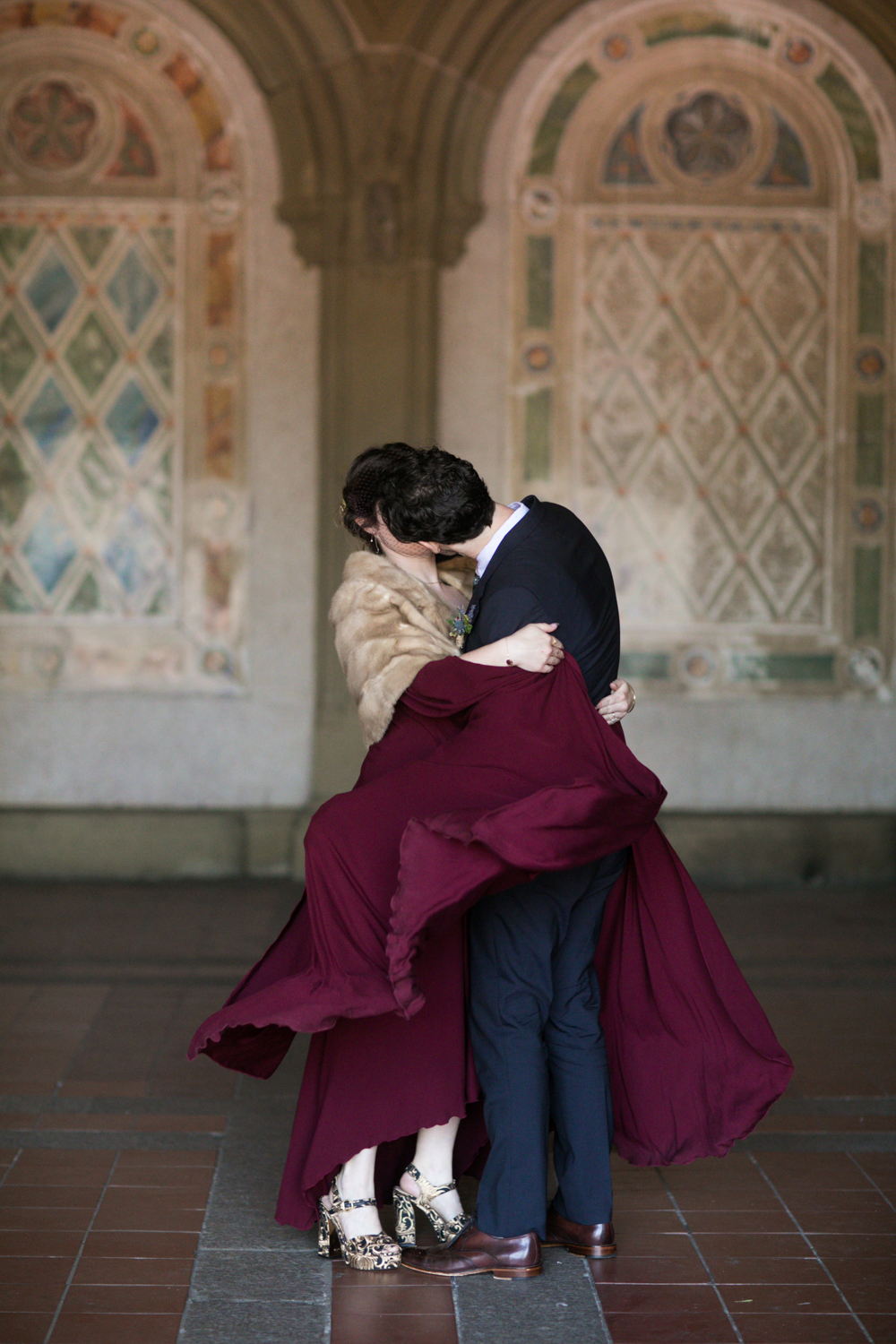 Portrait of the bide and groom kissing on their wedding day.