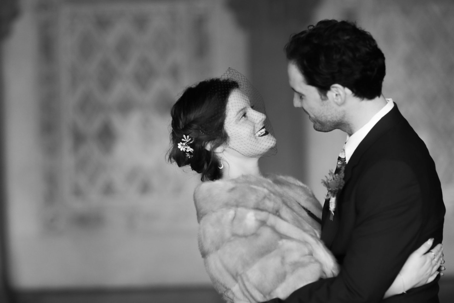 Black and white portrait of the bride and groom dancing on their wedding day.