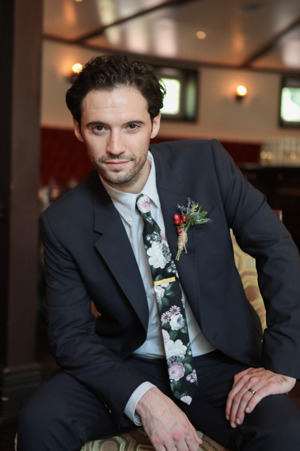 Portrait of the groom in a floral print tie.