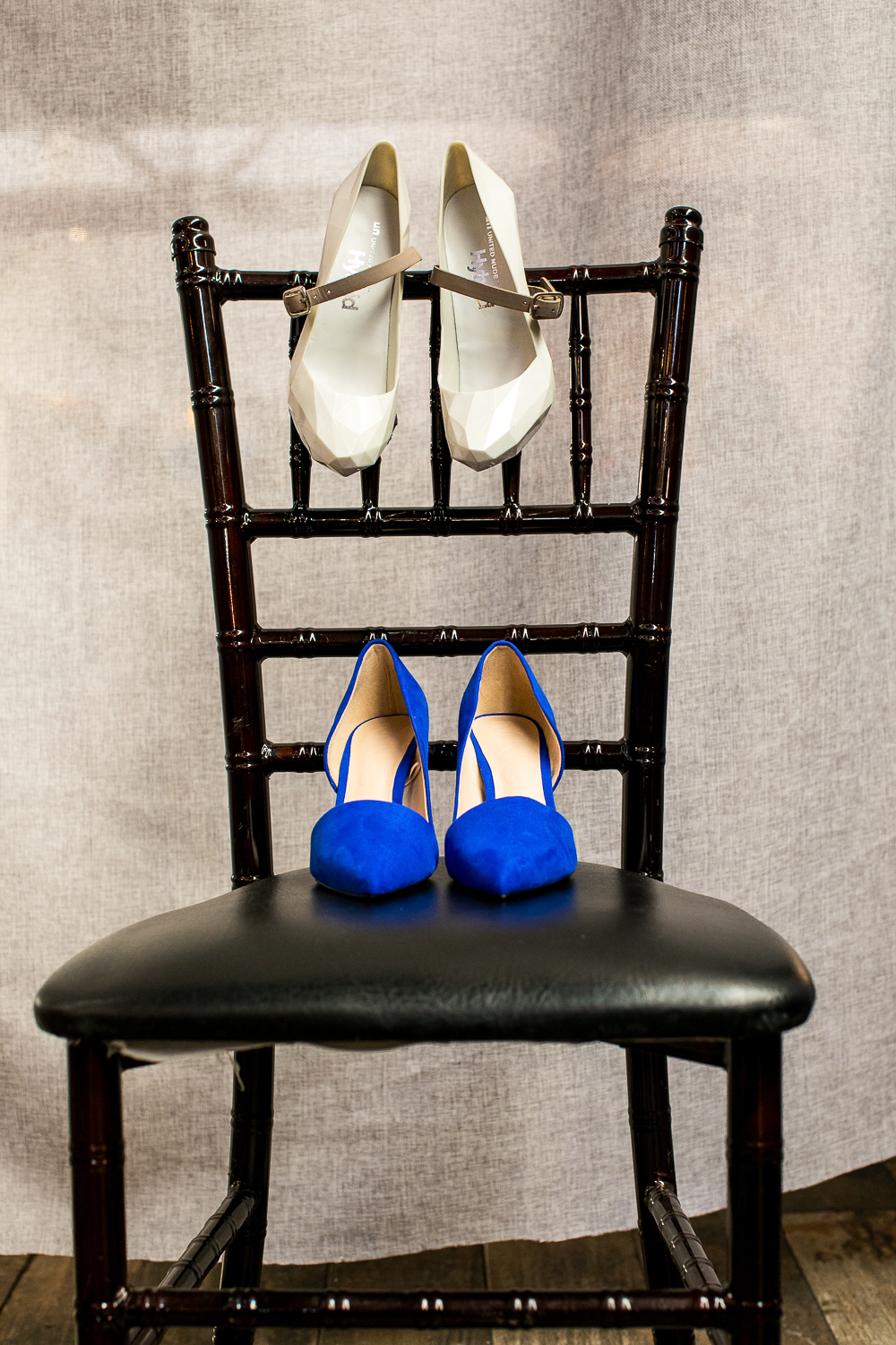 Wedding shoes on a black chair | 26 Bridge Wedding Photos | Lesbian Brooklyn Wedding | Kristin and Marisa's Wedding