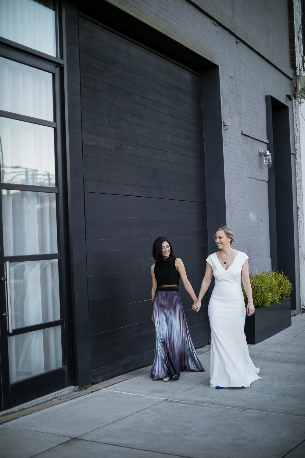 Brides holding hands | 26 Bridge Wedding Photos | Lesbian Brooklyn Wedding | Kristin and Marisa's Wedding