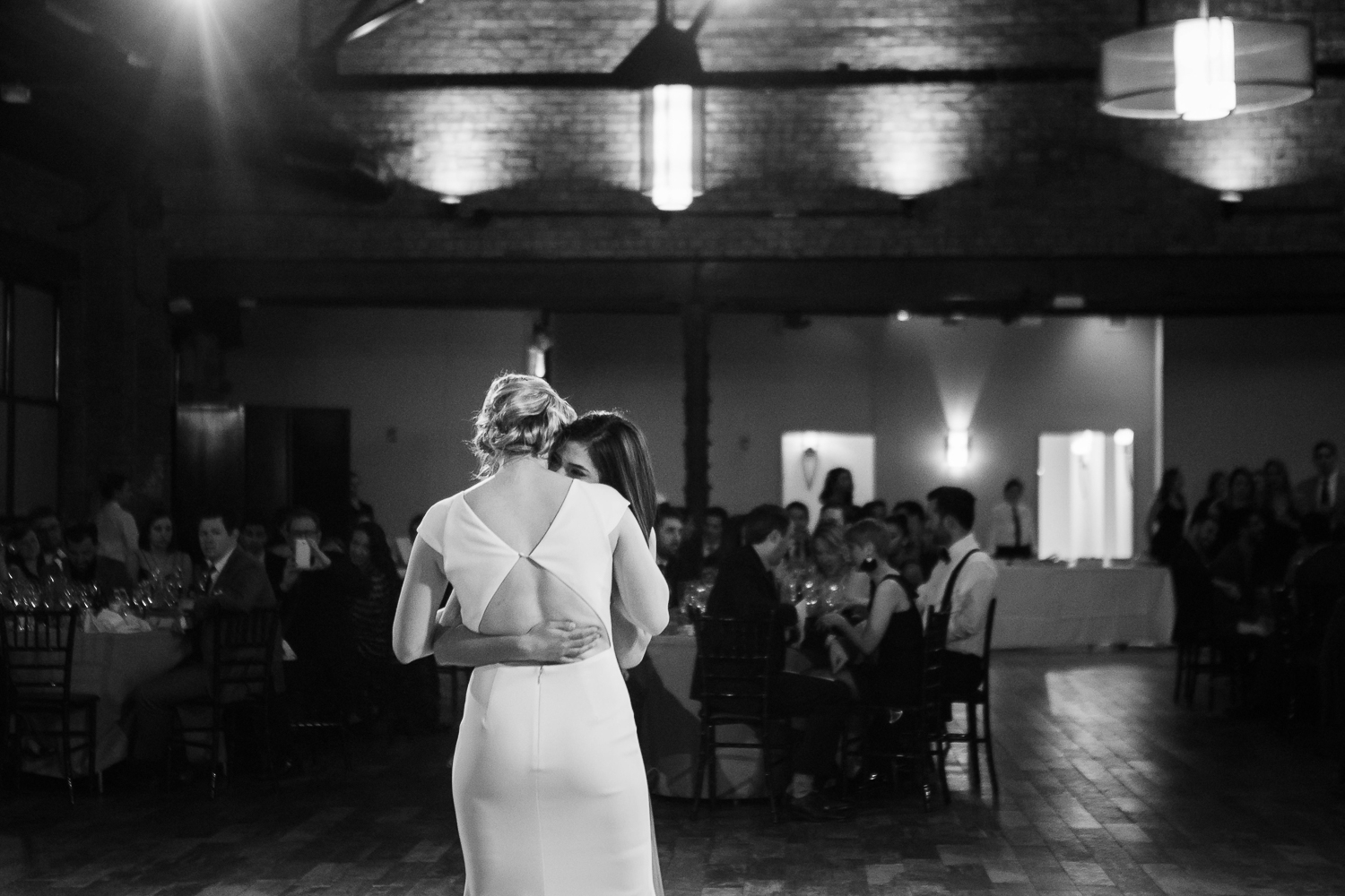 Black and white photo of the brides' first dance at their wedding | 26 Bridge Wedding Photos | Lesbian Brooklyn Wedding | Kristin and Marisa's Wedding