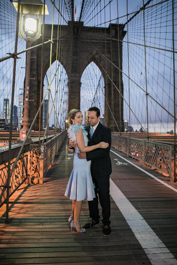 A couple poses on the Brooklyn Bridge at Sunrise | Brooklyn Bridge Anniversary Session | Brooklyn Bridge Wedding Photos | New York Couples Photos