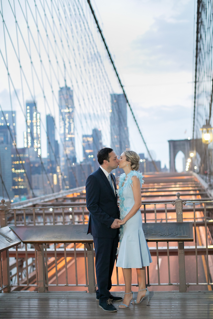 A couple poses on the Brooklyn Bridge at Sunrise | Brooklyn Bridge Anniversary Session | Brooklyn Bridge Wedding Photos | New York Anniversary Photographer