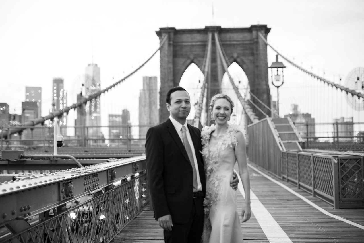 A couple poses on the Brooklyn Bridge at Sunrise | Brooklyn Bridge Anniversary Session | Brooklyn Bridge Wedding Photos | Brooklyn Wedding Photographer