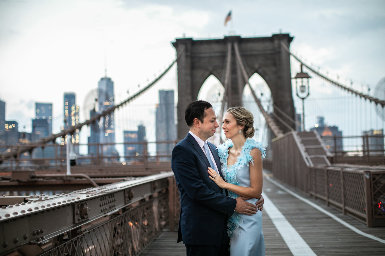 A couple poses on the Brooklyn Bridge at Sunrise | Brooklyn Bridge Anniversary Session | Brooklyn Bridge Wedding Photos | Brooklyn Anniversary Photographer