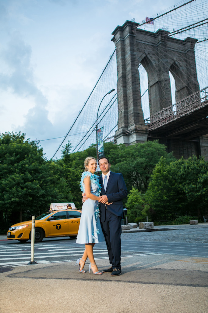 A couple poses in front of the Brooklyn Bridge at Sunrise | Brooklyn Bridge Anniversary Session | Brooklyn Bridge Wedding Photos | Brooklyn Engagement Photographer