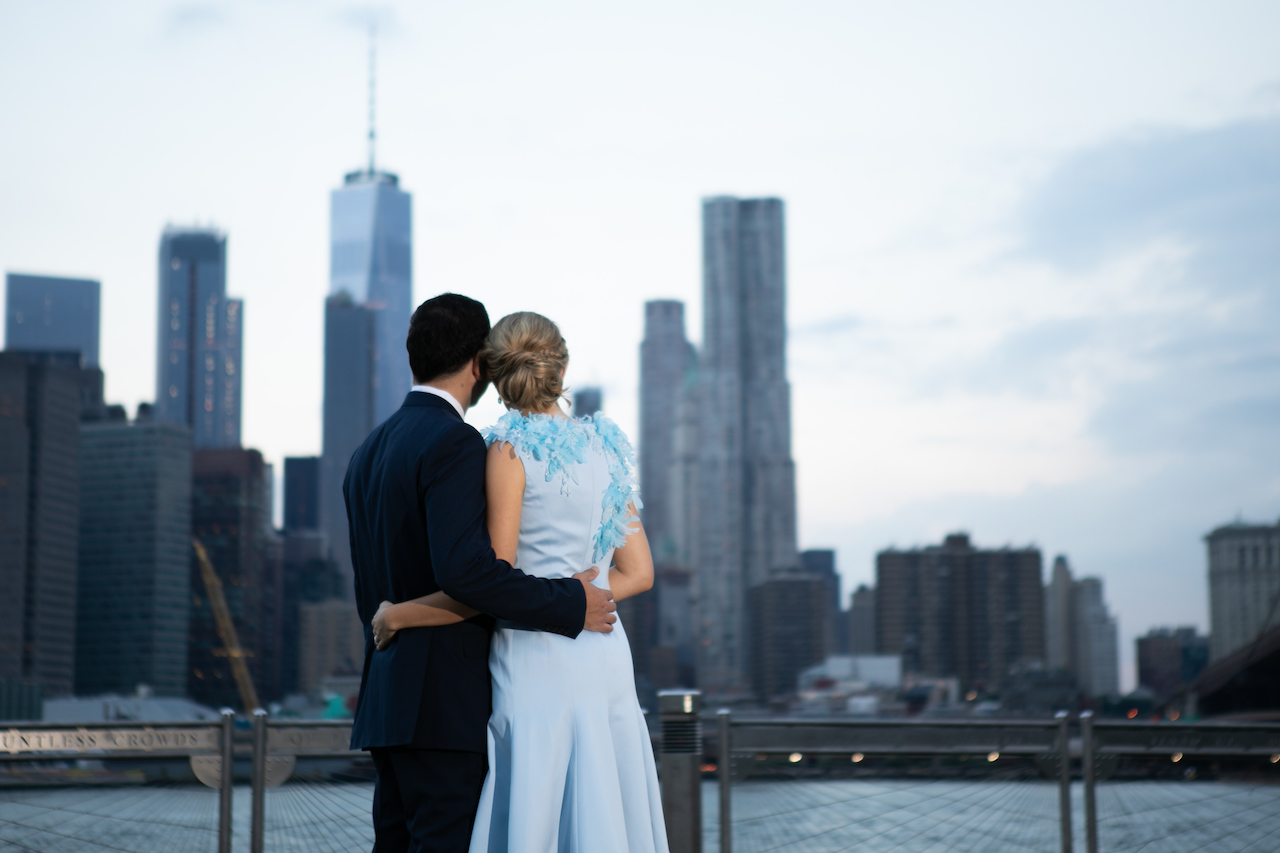 A couple looks out over the New York skyline at Sunrise | Brooklyn Bridge Anniversary Session | Brooklyn Bridge Wedding Photos | Early Morning Brooklyn Bridge ENgagment photos