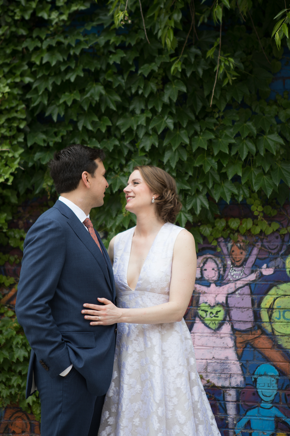 bride and groom portrait in front of graffiti and ivy in Brooklyn