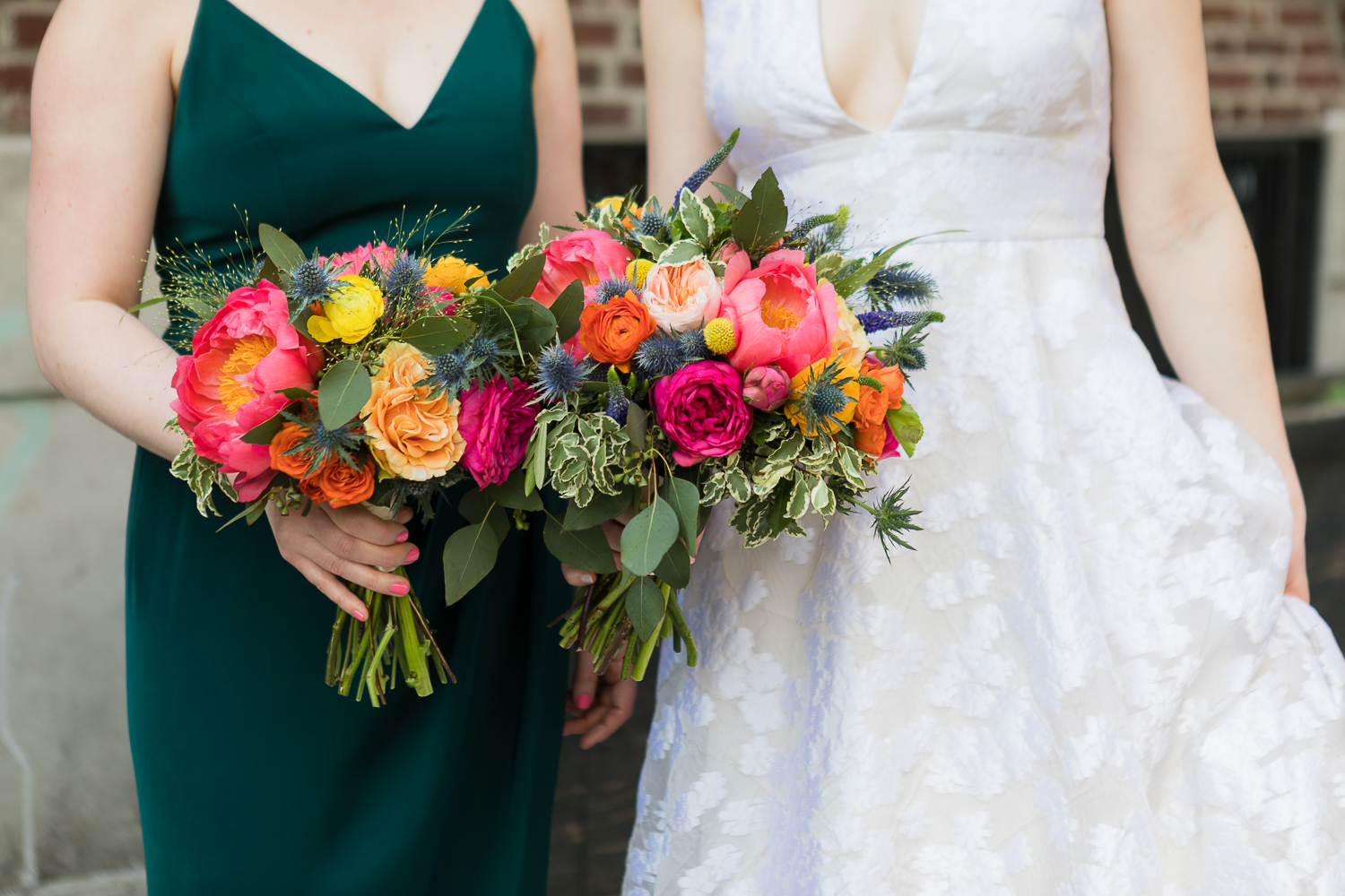 bride and bridesmaid holding peony bouquets
