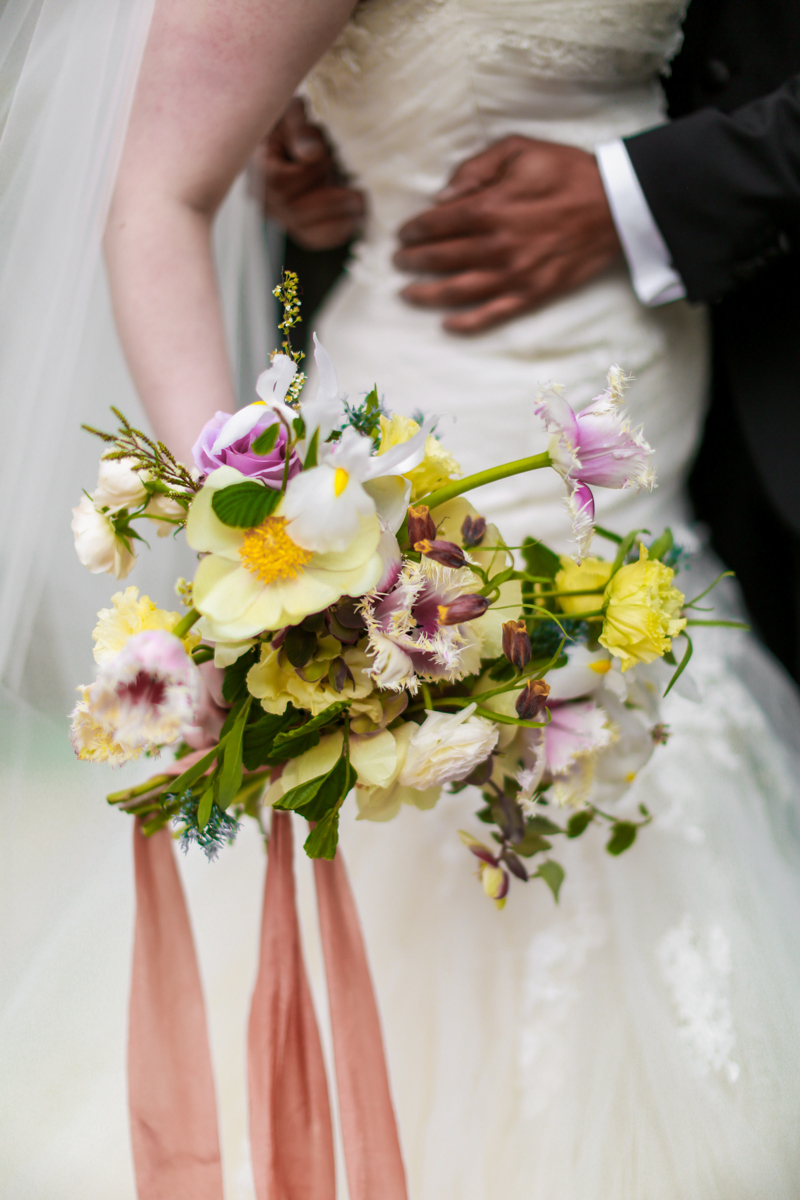 Manhattan wedding - NoMad Hotel Rooftop Wedding in New York City - The bride carries her pink, yellow, and purple FLWR Studio bouquet.