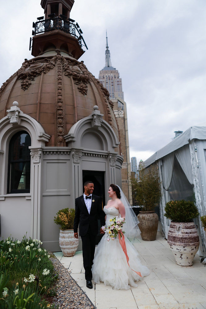 Manhattan wedding - NoMad Hotel Rooftop Wedding in New York City - The bride and groom pose for rooftop wedding portraits. The bride wearing an Enzoani wedding dress from The Bridal Garden and Jaclyn Jordan veil and the groom wearing a Hugo Boss tuxedo.