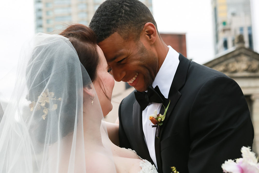 NoMad Hotel Rooftop Wedding in New York City - The bride and groom pose for rooftop wedding portraits.