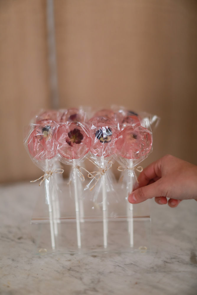 Pressed flower lollypop wedding favors from The Meringue Bakeshop | NoMad Hotel Wedding in New York City