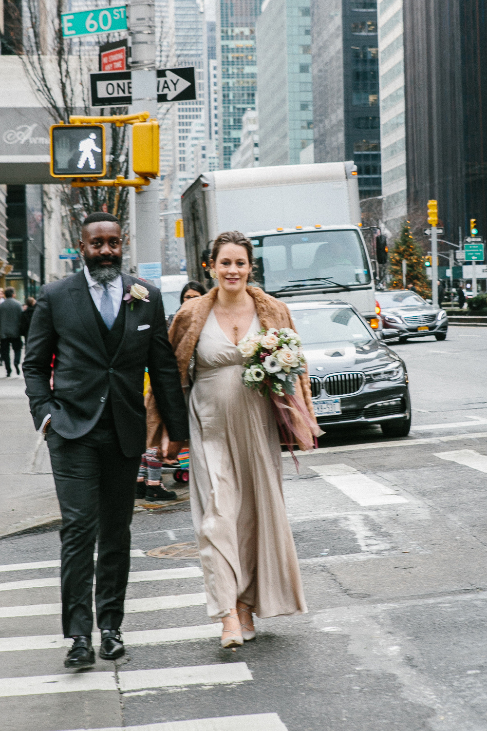 The bride and groom crossing the street in Manhattan. | Upper West Side Intimate Wedding | Kate & Sylvester's wedding in Manhattan.