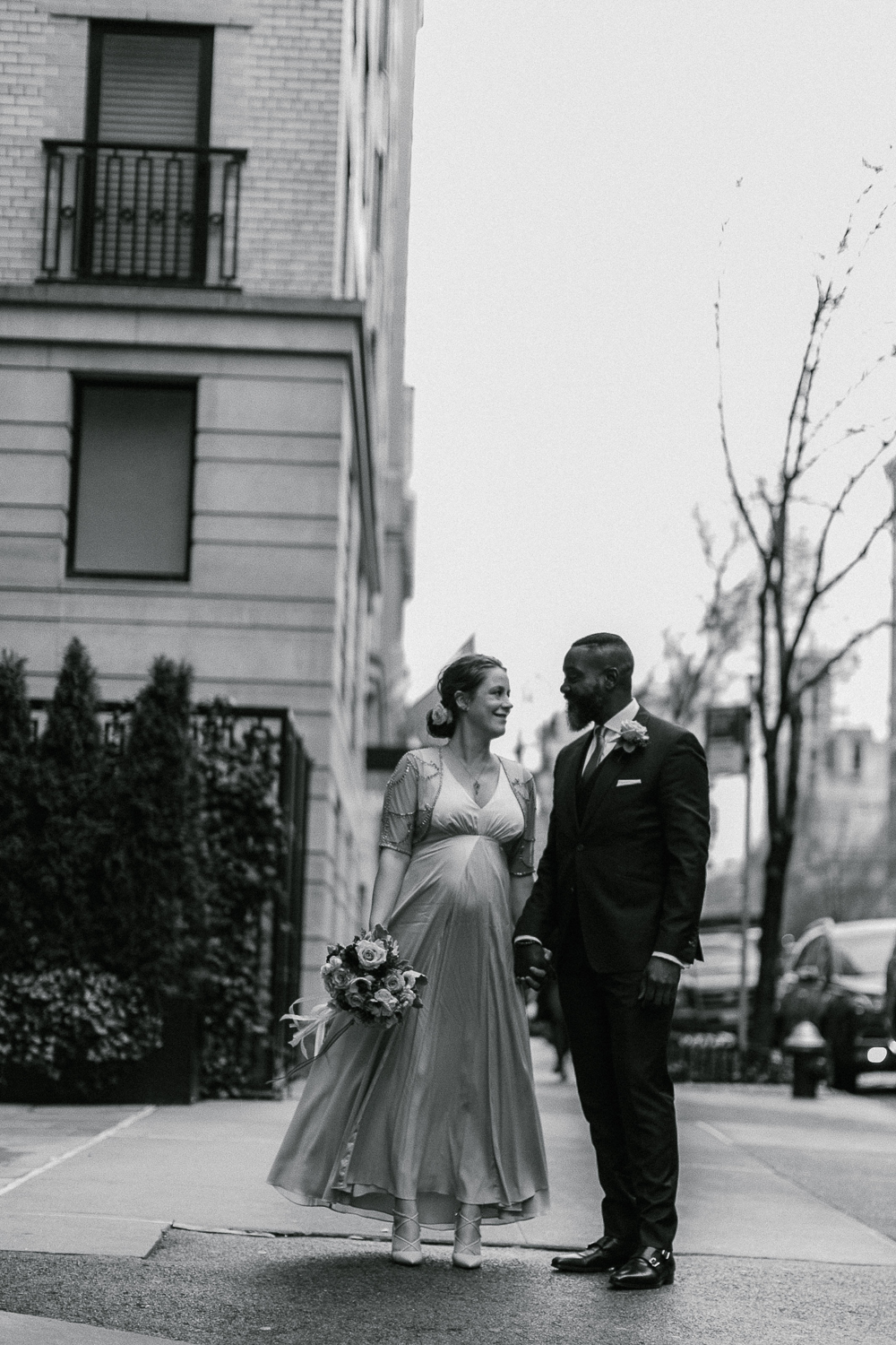 Black and white portrait of the bride and groom pose outside the Upper West Side Wedding Venue. | Upper West Side Intimate Wedding | Kate & Sylvester's wedding in Manhattan.