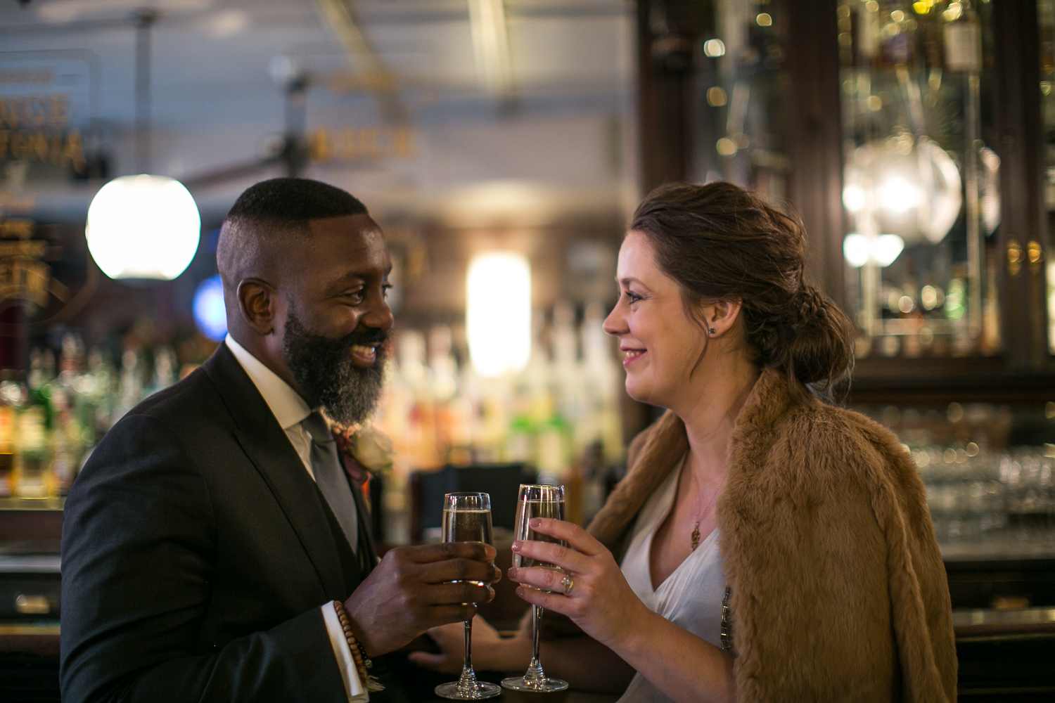Portrait of a bride and groom toasting with champagne at their intimate restaurant wedding venue in Manhattan. | Upper West Side Intimate Wedding | Kate & Sylvester's wedding in Manhattan.