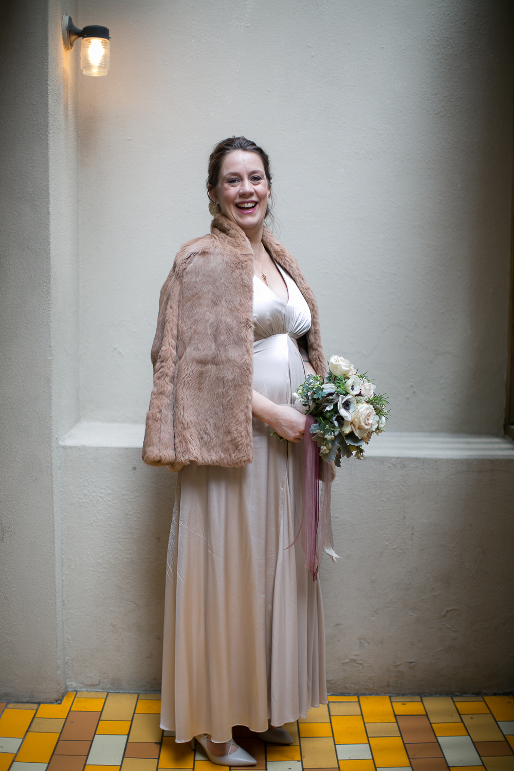 Portrait of the bride wearing a blush dress and blush fur cape. | Upper West Side Intimate Wedding | Kate & Sylvester's wedding in Manhattan.