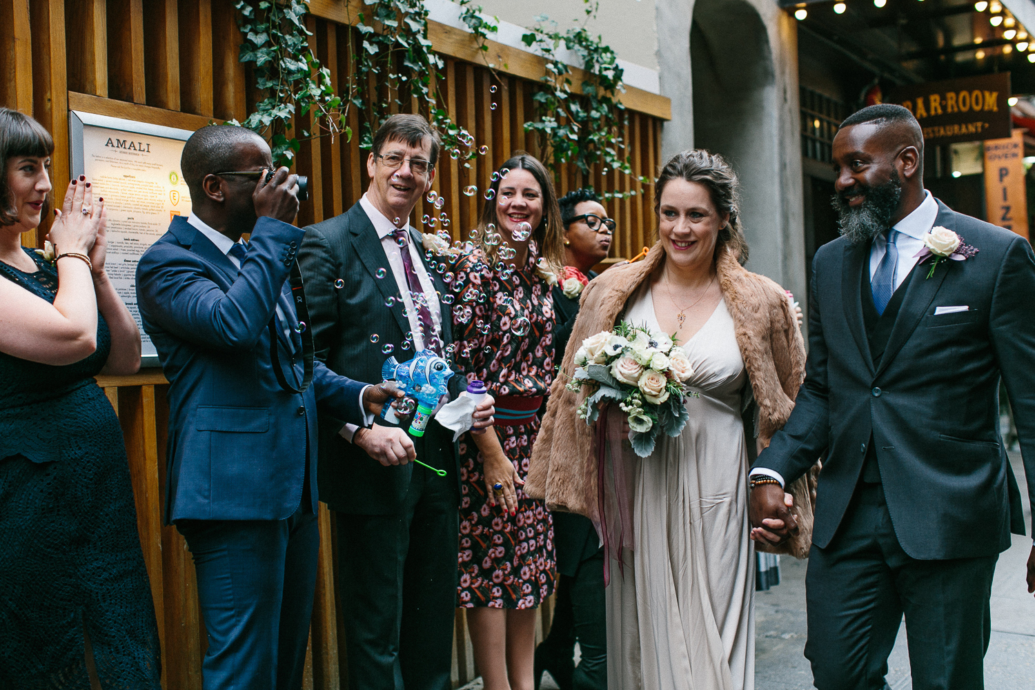 Introducing the bride and groom with bubbles at their intimate restaurant wedding in Manhattan. | Upper West Side Intimate Wedding | Kate & Sylvester's wedding in Manhattan.