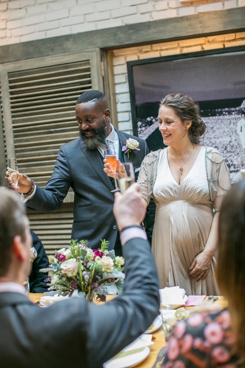 The bride and groom toasting at their Intimate Restaurant Wedding in Manhattan. | Upper West Side Intimate Wedding | Kate & Sylvester's wedding in Manhattan.