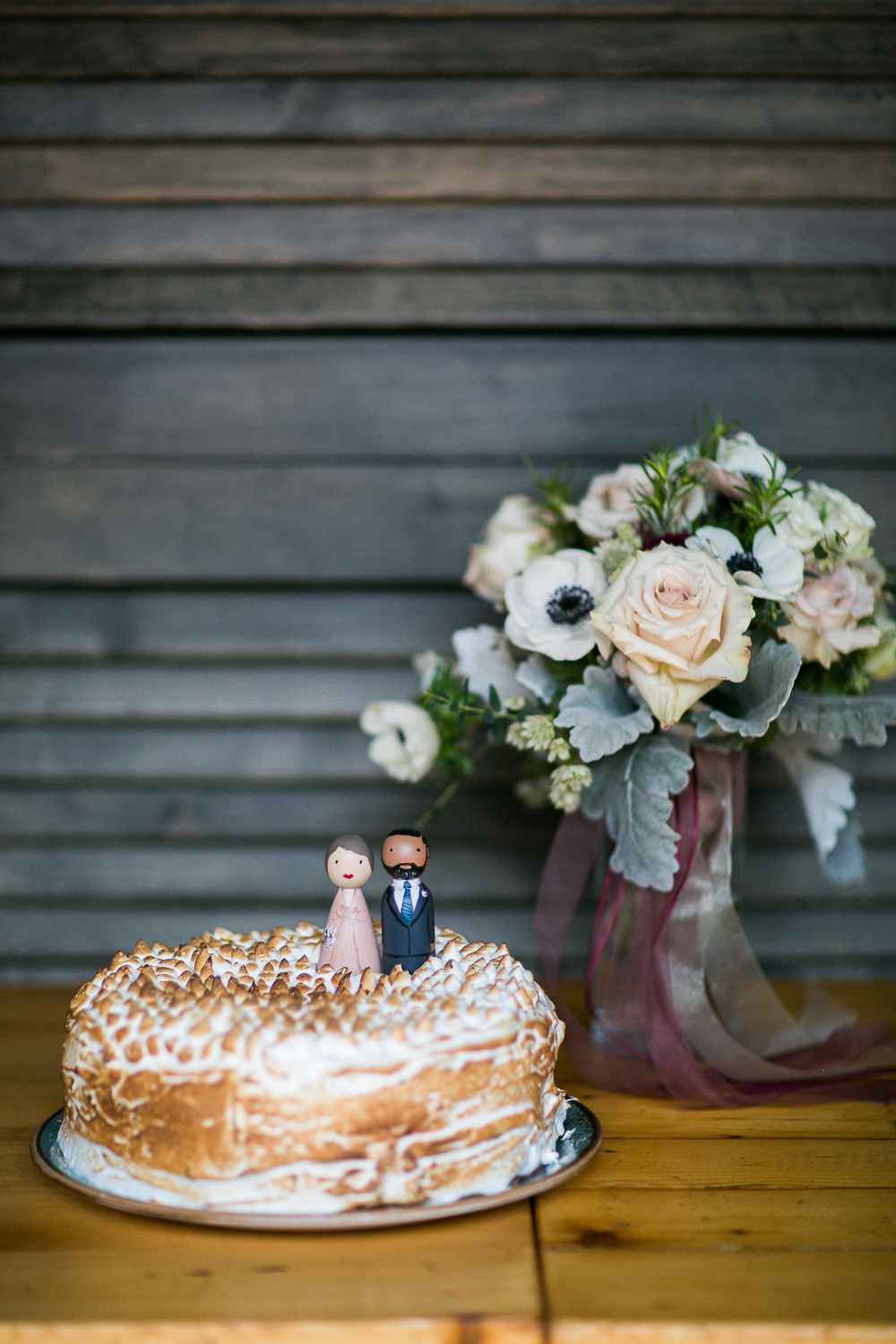 Single tier wedding cake with wooden cake toppers at an Intimate Restaurant Wedding in Manhattan | Upper West Side Intimate Wedding | Kate & Sylvester's wedding in Manhattan.