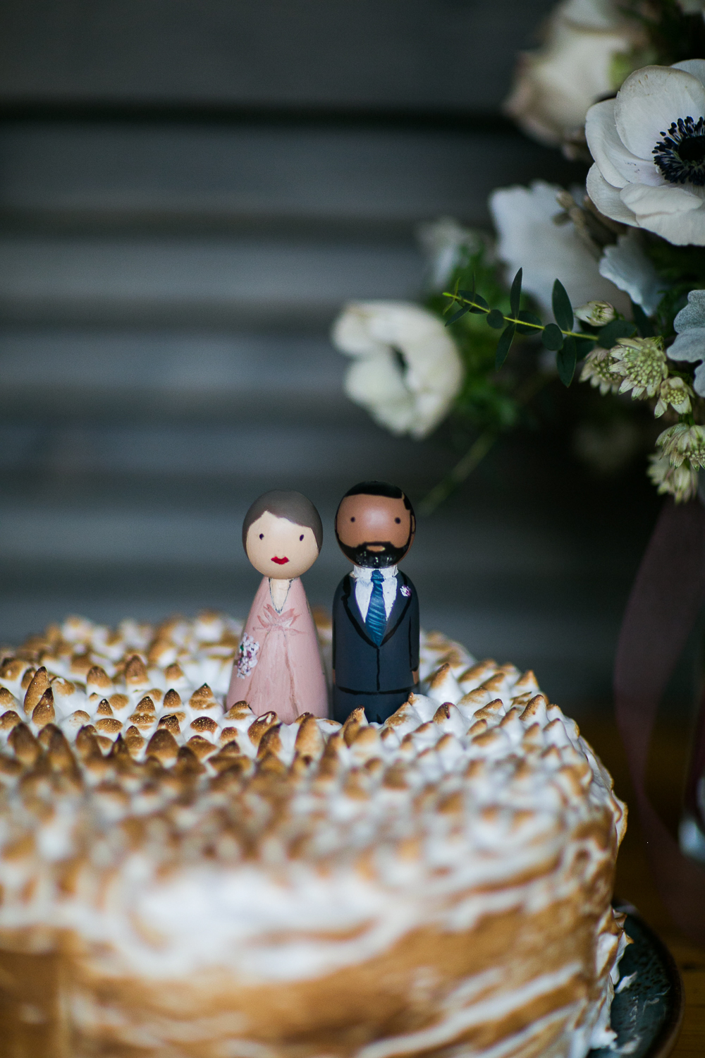 Single tier wedding cake with wooden cake toppers at an Upper West Side restaurant wedding venue. | Upper West Side Intimate Wedding | Kate & Sylvester's wedding in Manhattan.