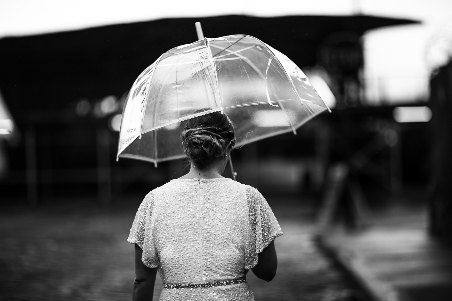 New York Bride with a clear plastic umbrella in the rain.| Intimate Wedding at the Malthouse in Manhattan, New York City.