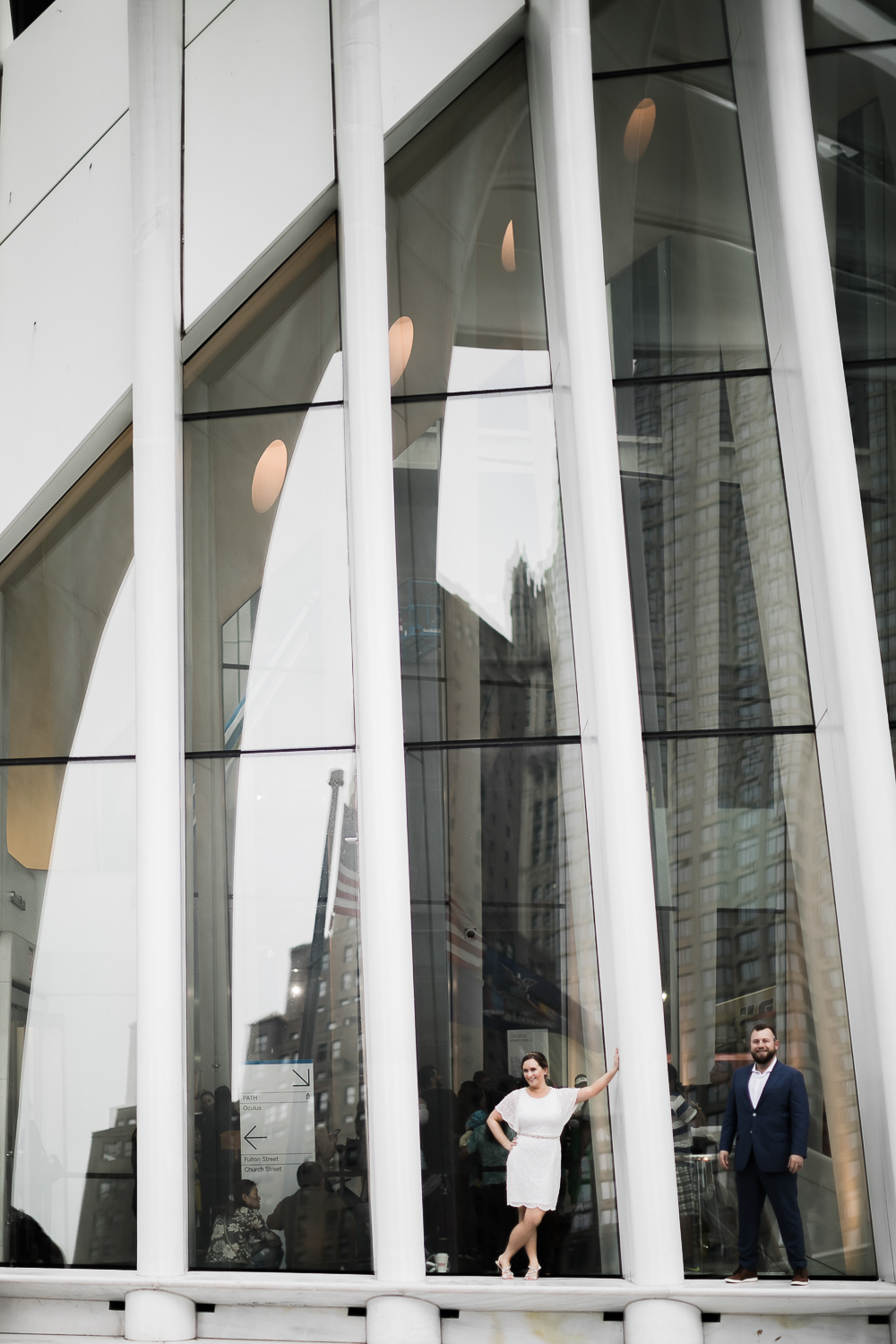 Bride and groom posing at The Oculus in New York City. The Oculus wedding portraits. | Intimate Wedding at the Malthouse in Manhattan, New York City.