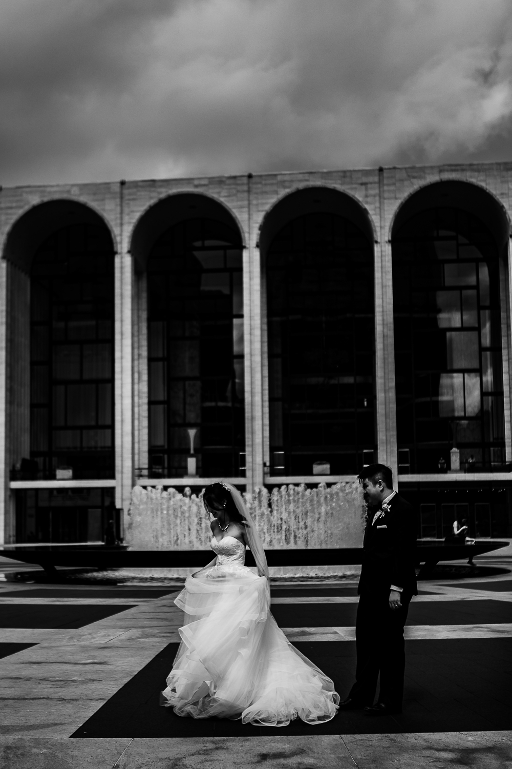 Black and white portrait of a couple posing for wedding portraits at Lincoln Center in New York City | Lincoln Center Wedding Photos | Jason and Susanna's Glam NYC Elopement