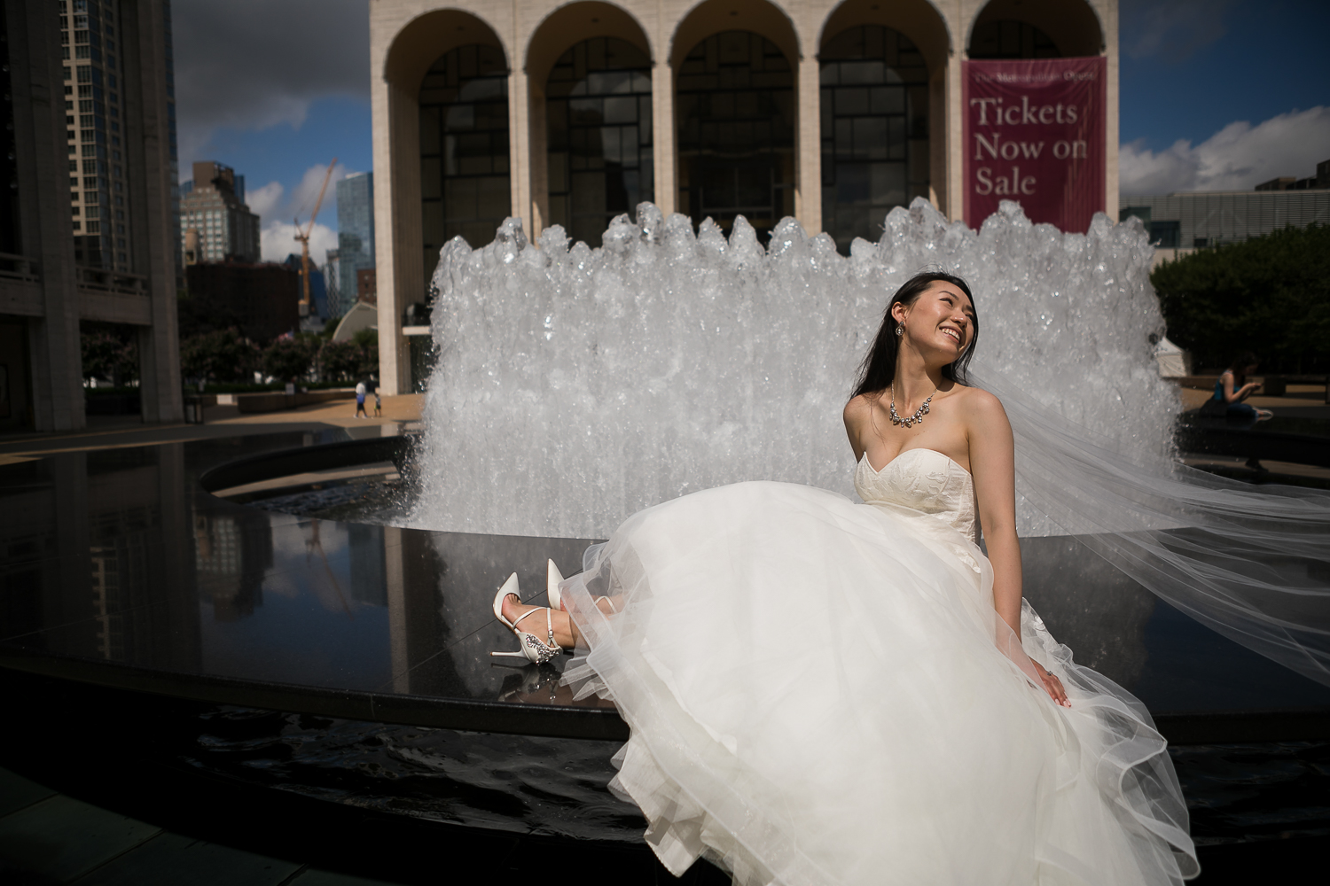 Bride in a strapless white wedding dress at Lincoln Center in New York City | Lincoln Center Wedding Photos | Jason and Susanna's Glam NYC Elopement