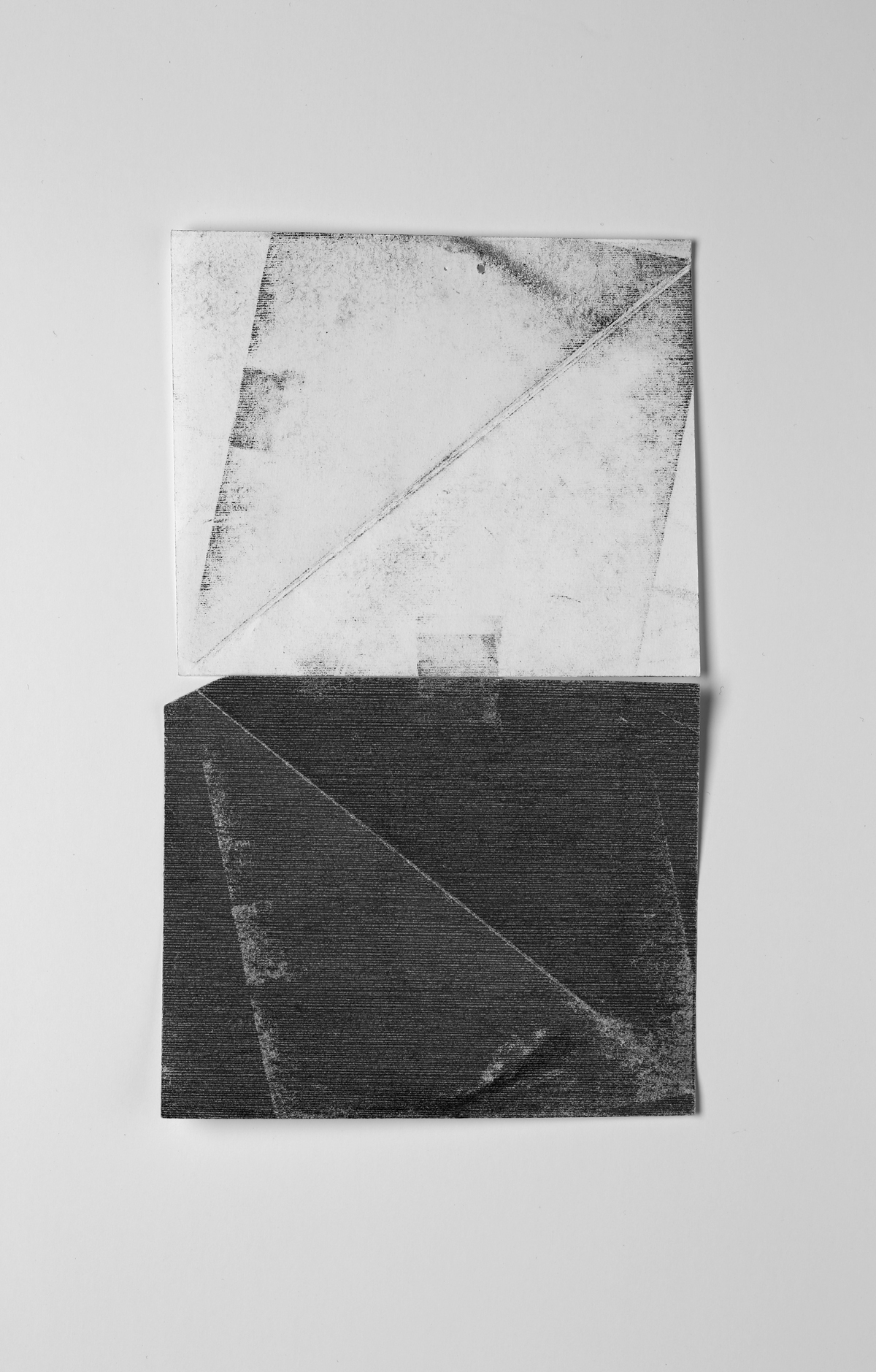 Untitled (test, from the ongoing series, Divided/Defined, Weights Measures and Emotional Geometry)   2013, pressed and folded transfer paper taped to regular bond paper, 11.5 x 9 inches