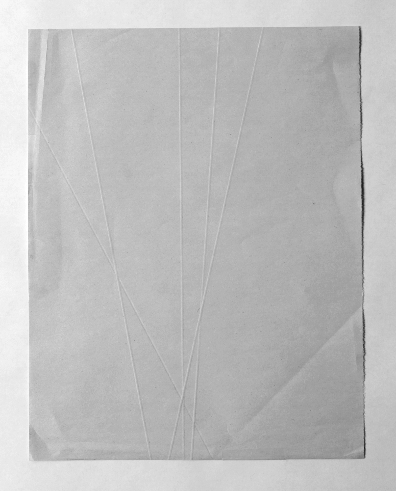 from the ongoing series: O/, Divided/Defined, Weights, Measures, and Emotional Geometry  2013, Folded newsprint. 8 x 10 inches folded