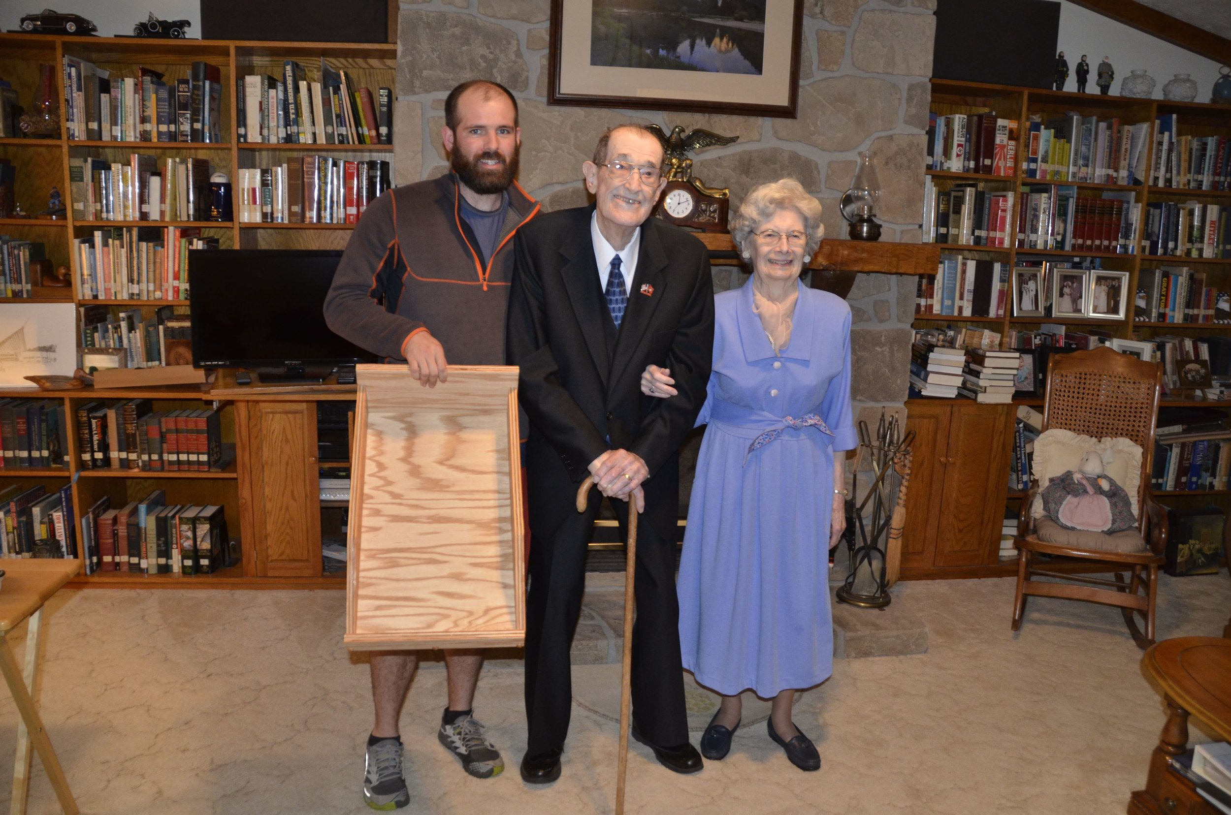 Holding a finished wooden divider with my Grandparents!