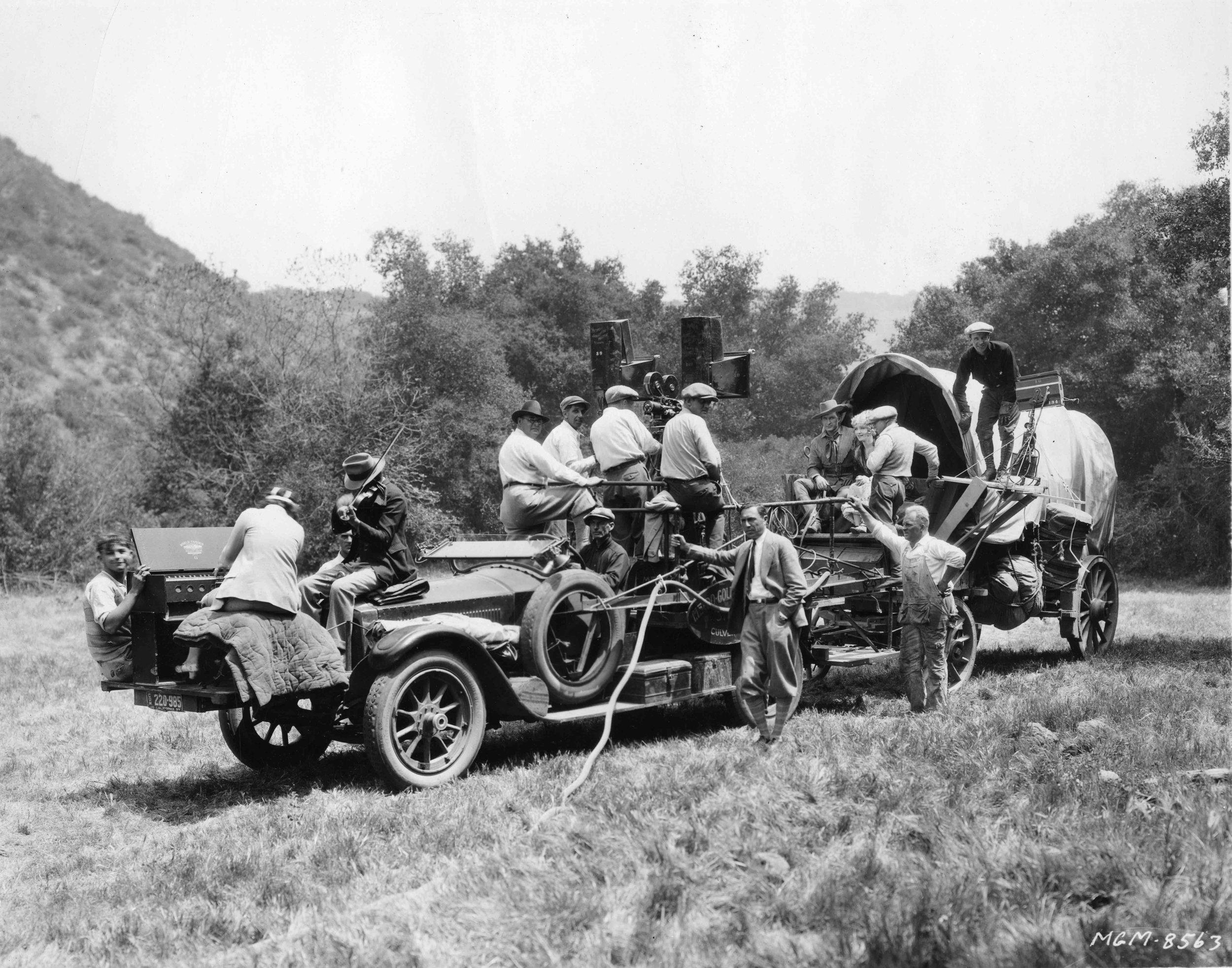 Fig03_04 Behind the scenes - locations- Lasky Ranch - MGM 1927 'The Frontiersman' with Tim McCoy, director Reginald Barker and Claire Windsor on Covered Wagon - Set musicians.jpg