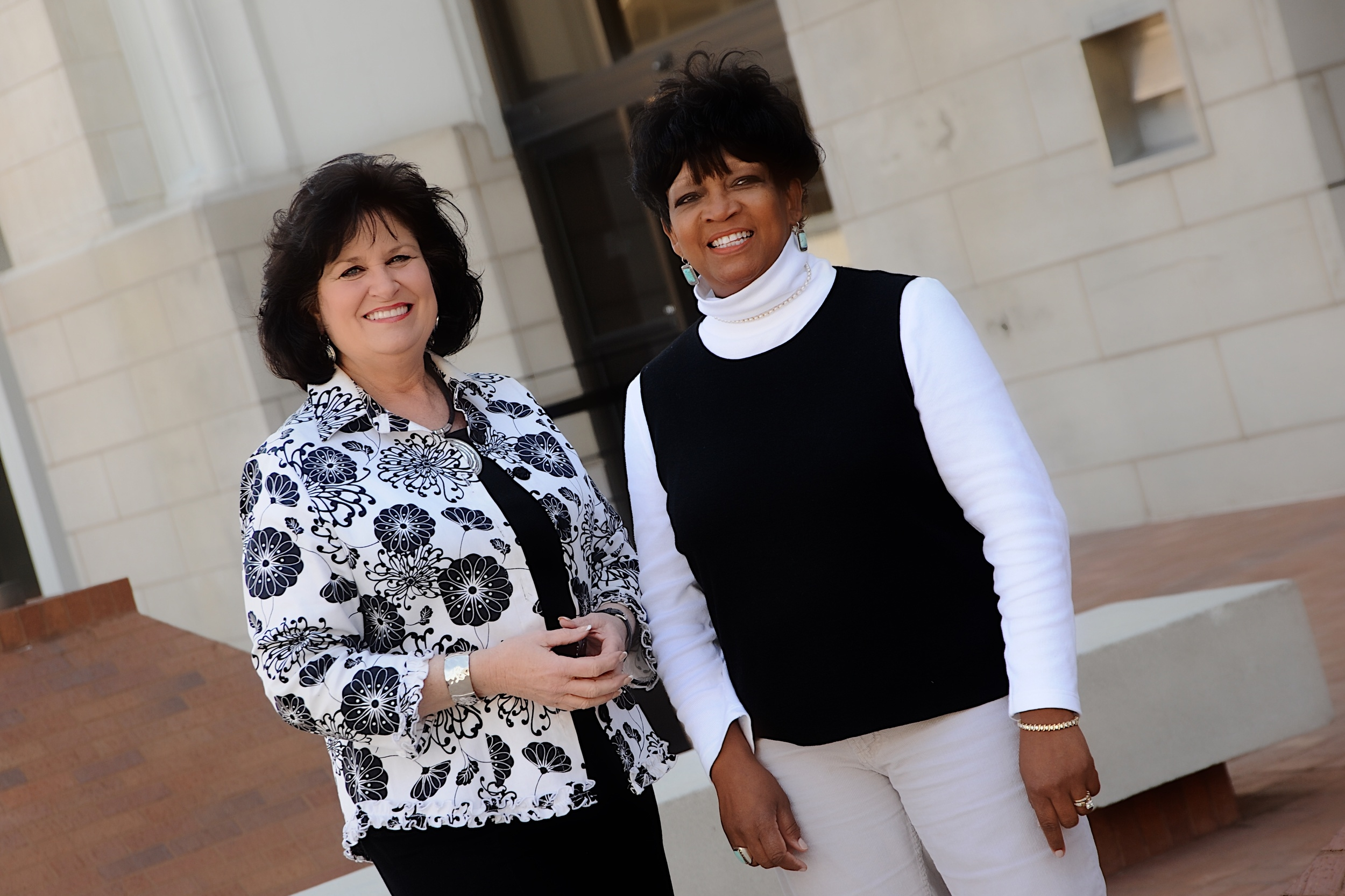 Christie Fowler and Frances Jordan, Greenwood Cultural Center Executive Director, helped integrate Tulsa Central High School in the mid/late 1960s and were close friends. After losing touch, they reconnected about 40 years later. Photographed in front of their former high school.