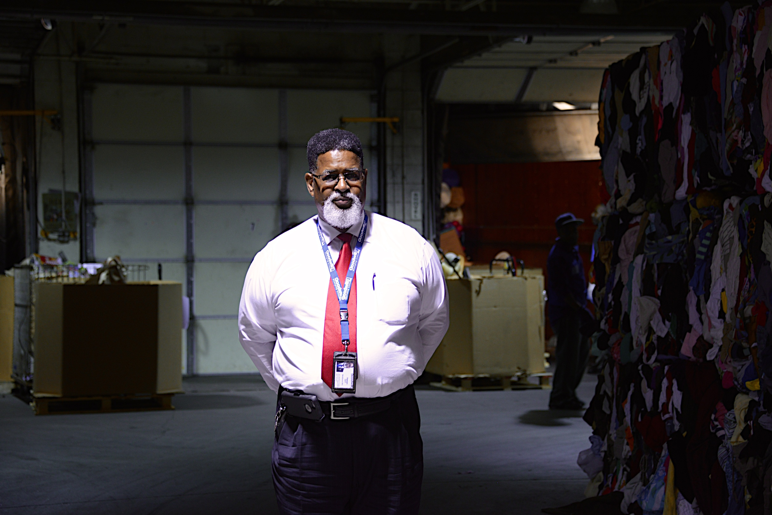 Photographed in the Goodwill donation warehouse. The sale of items supports Hasan's work.