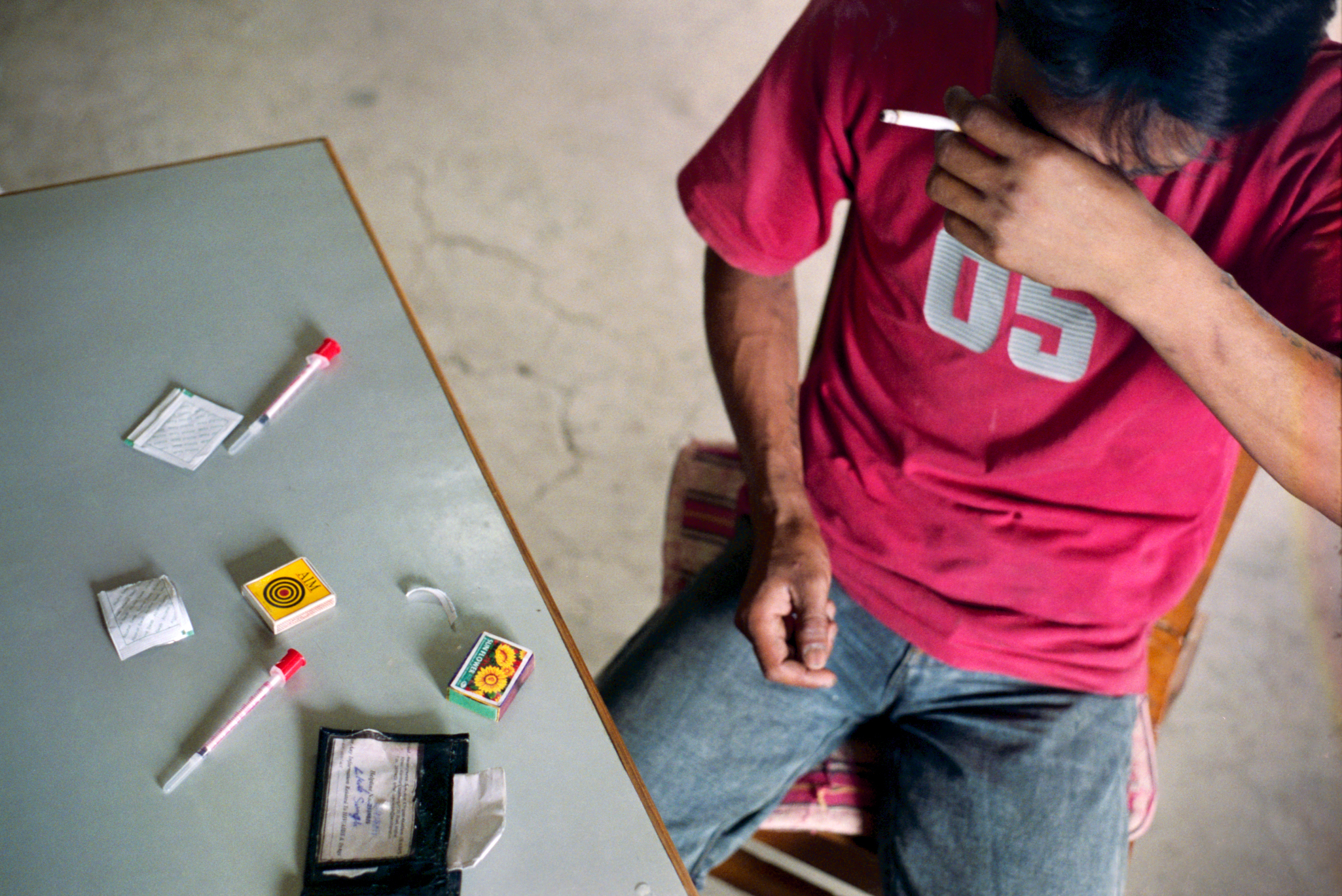 Heroin and needle use is common in NE India which borders Burma and is a major drug route.  HIV levels in this area are some of the highest in the country.  Many social service organizations have begun needle exchange programs to reduce the spread.  Kola will sometimes steal to get the 50 rupees (approx. one dollar) he needs to fix.