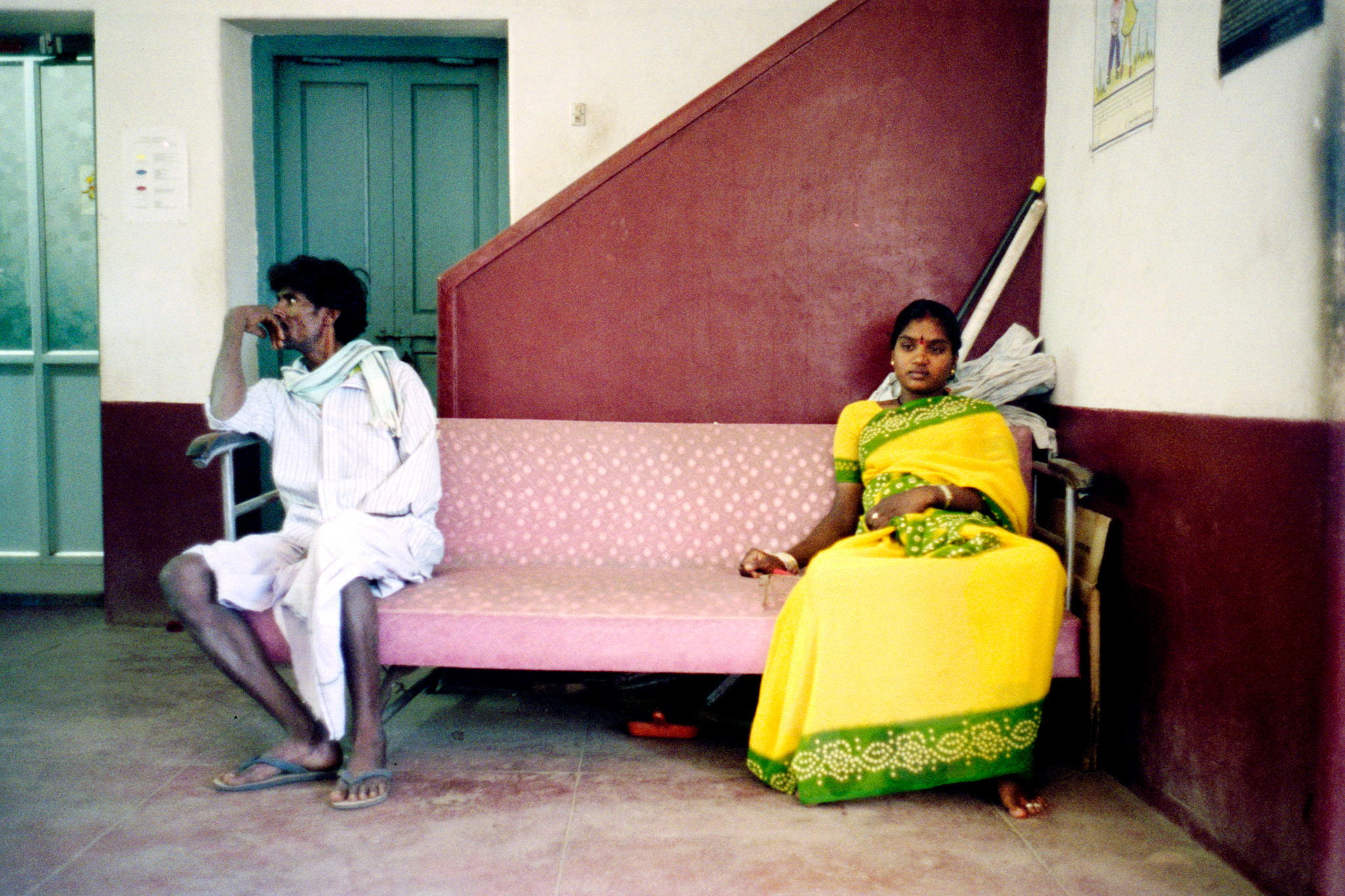 Shobha and her father wait at Asha Kirana, an HIV clinic. Shobha is 19 and has been married for little over a year. She is seven months pregnant and positive. Her husband, a truck-driver, does not want the child. One month later, Shobha will abort her child, leave her husband and return to her family.