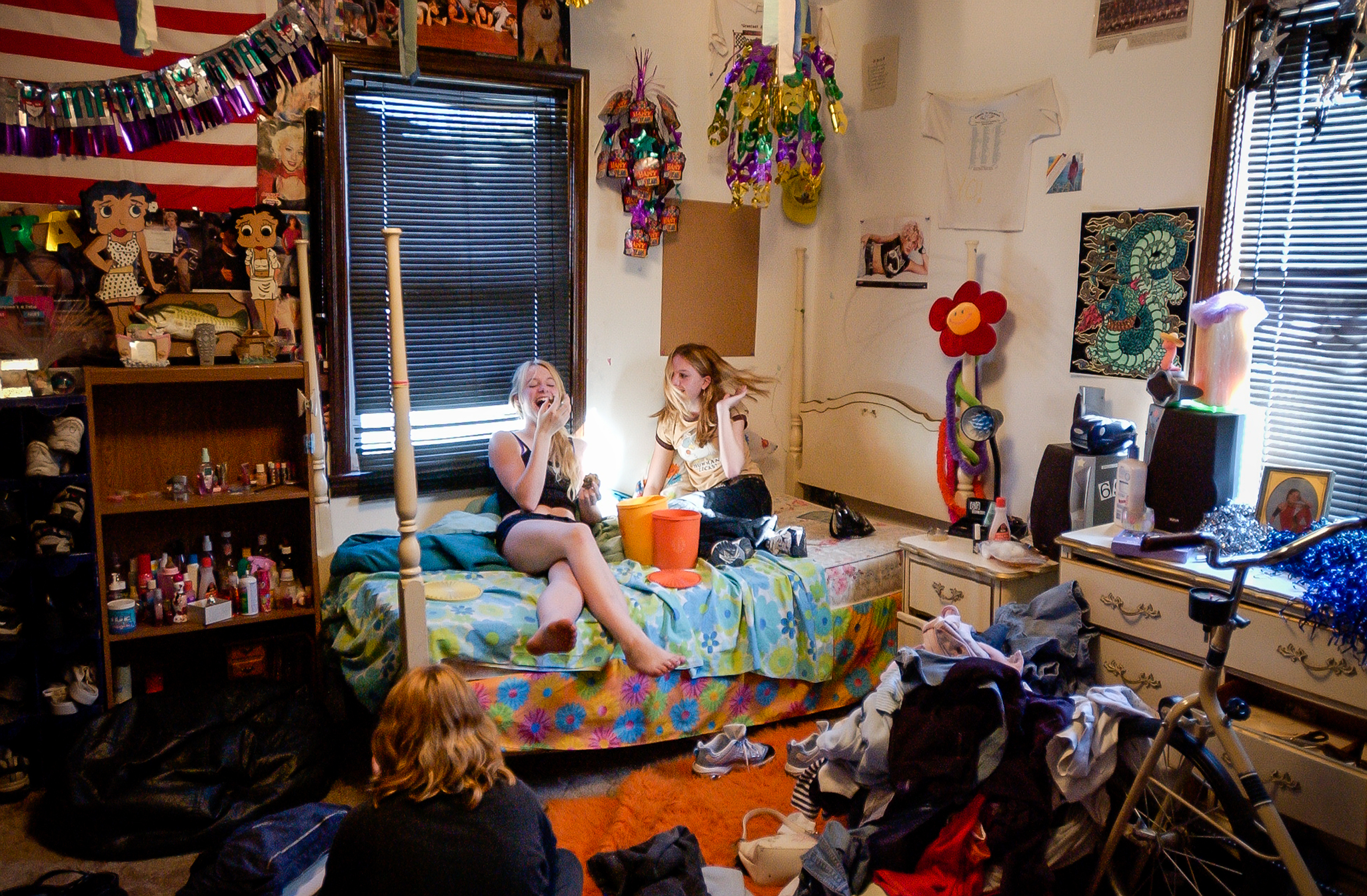 Spirit, Bre, and Brittney share mom's homemade cookies while listening to music. Spirit's room is filled with pictures of Nelly, Britney Spears, fast cars, professional wrestlers and her immense wardrobe.