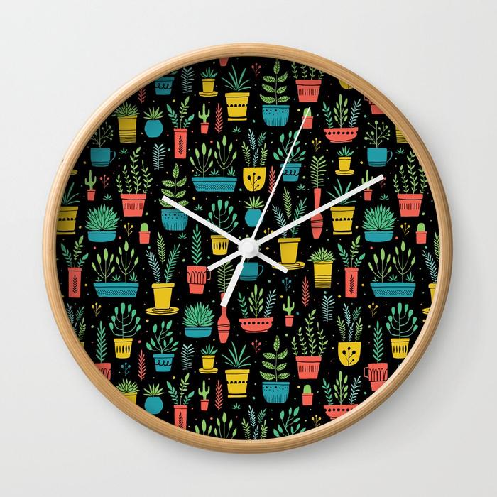 bright-window-plants-wall-clocks.jpg